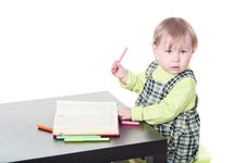 Free The Little Child Drawing In Book Royalty Free Stock Photos - 13819448
