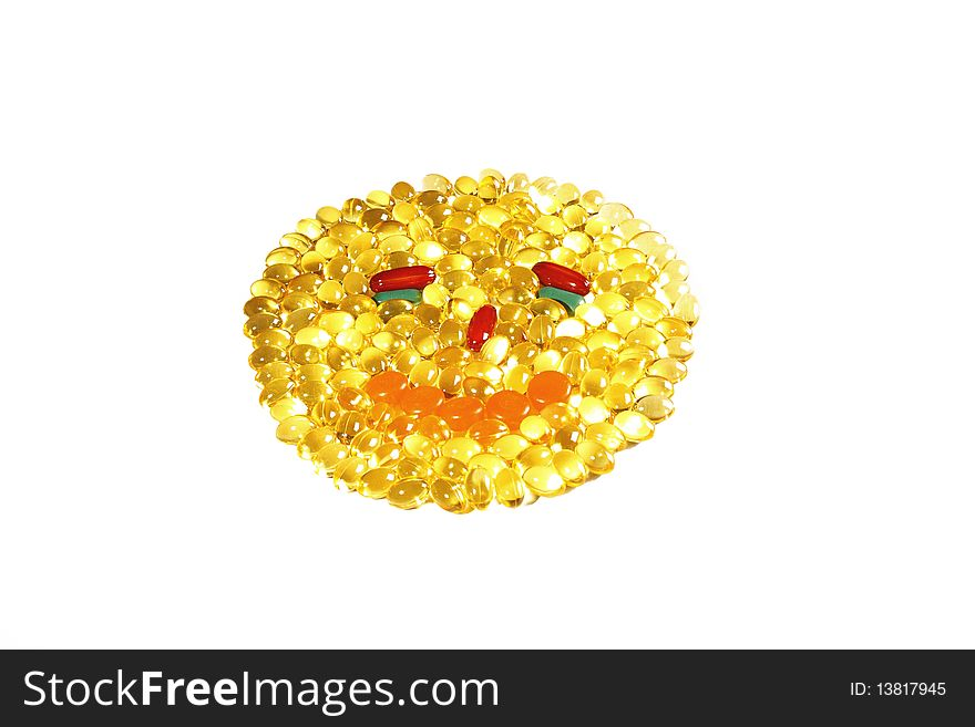 Yellow transparent pills in the shape of face
