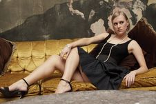 Free Attractive Woman On A Couch Royalty Free Stock Photography - 13823207