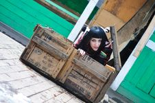 Free The Girl Gets Out Of The Shipping Container Royalty Free Stock Photo - 13823235