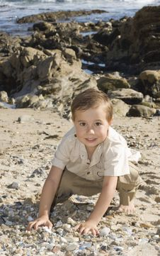 Free Boy At The Beach Playing With Stones Stock Photos - 13823243
