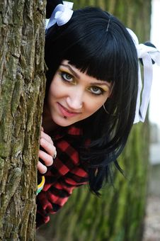 Free Beautiful Girl Looks Out From Behind A Tree Stock Image - 13823331