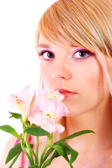 Free Portrait Of A Woman Holding Pink Flowers Royalty Free Stock Photos - 13823418
