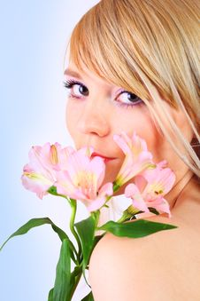 Free Portrait Of A Woman Holding Pink Flowers Royalty Free Stock Photography - 13823467