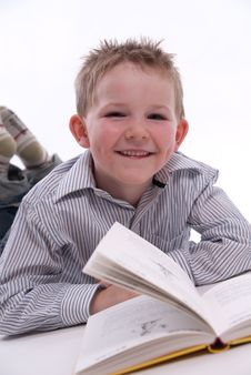 Free Boy Reading A Book Royalty Free Stock Images - 13823499