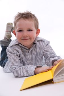 Free Boy Reading A Book Stock Photo - 13823510