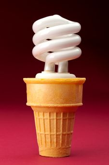 Free A Compact Fluorescent Bulb In An Ice Cream Cone Stock Photos - 13825943