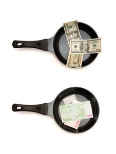 Free Two  Frying Pans With Dollar And Euro Bills Stock Photos - 13828423