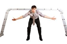 Free Young Businessman Stangin In Gates Like Goalkeeper Royalty Free Stock Photography - 13830667