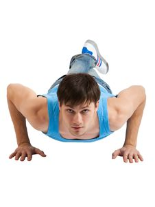 Handsome Young Man Making Push-ups. Isolated Stock Photo