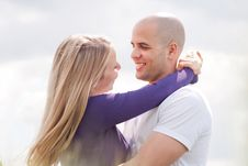 Free Loving Couple Standing Under The Blue Sky Stock Photography - 13834542