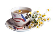 Free A Cup Of Chamomile Tea With A Daisies Stock Photography - 13834752