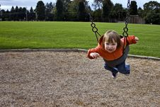 Free Child Swinging Stock Photography - 13835542
