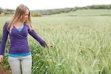 Free Portrait Of Lady Walking Between The Grass Stock Image - 13835681