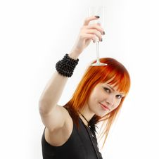 Beautiful Red-haired Girl Lifts A Toast Royalty Free Stock Images