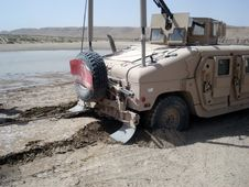 US Army Humvee Stuck In Sand Stock Photography