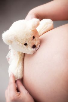 Free Teddy Bear Hugs Pregnant Belly Royalty Free Stock Photography - 13836877
