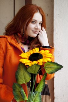 Free Pretty Girl Walking With A Sunflower City Stock Photos - 13837873