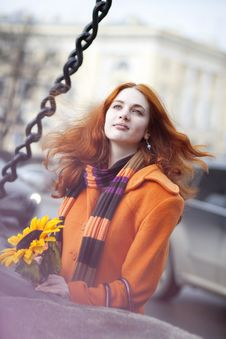 Free Pretty Girl Walking With A Sunflower City Stock Image - 13838021