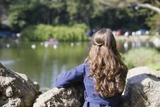 Woman Looking At Pond Stock Photo