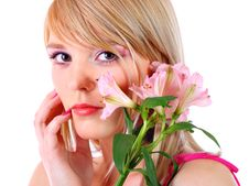 Free Portrait Of A Woman Holding Pink Flowers Royalty Free Stock Photos - 13841748
