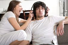 Boy In Headphones With Girl Stock Images
