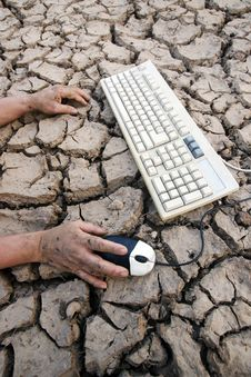 Free Hand Keyboard Earth Crack Stock Photography - 13844492