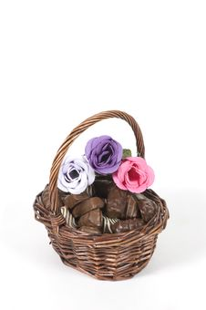 Free Dark Brown Basket Filled With Chocolate And Roses Stock Photo - 13845160