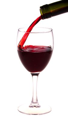 Red Wine Pouring From A Wine Bottle Stock Photo