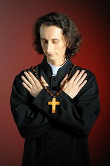 Free Conceptual Portrait Of Praying Priest Stock Photography - 13848522