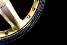 Metall Gold Wheel Disc On Black Background Stock Image