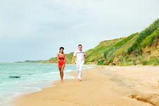 Free Running Along The Beach Stock Photos - 13849013