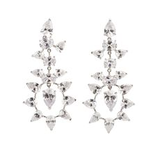 Free Silver Earrings On White Stock Photos - 13849543