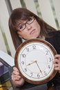 Free Unhappy Woman Holding Big Watch Stock Images - 13854214