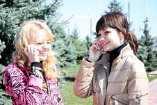 Free Two Girls Call By Phone In A Park Stock Images - 13851174
