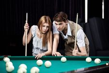 Free The Young Couple Plays Billiards Stock Image - 13853221