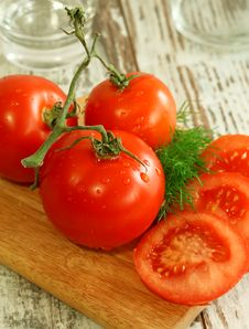 Free Fresh Tomatoes With Water Drops On Wooden Stock Images - 13853414
