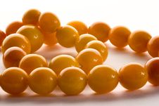Free Amber Chaplet Macro With Sparkles Of Light On The Stock Photos - 13853523