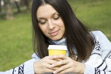 Free Beautiful Girl In A Park Drinking Coffee Royalty Free Stock Photo - 13854705