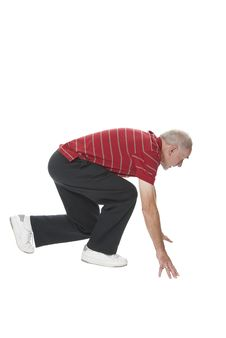 Elderly Man Squatting Ready To Run Stock Image