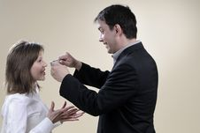 Free White Man Trying To Close His Wife Mouth Stock Images - 13857804