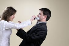Free Angry Wife Gluing His Partner Mouth Stock Photography - 13857862