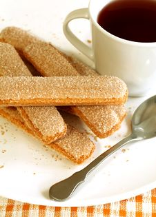 Free Cookies Strewed By Sugar And Cup Of Tea Royalty Free Stock Image - 13858206