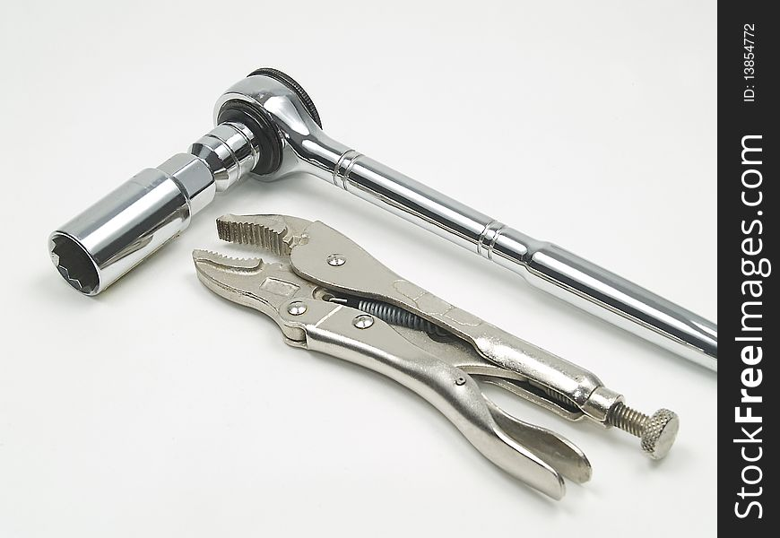 Ratchet, spark plug socket and locking pliers
