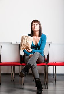 Worried Young Woman Sitting And Looking Up Stock Photography