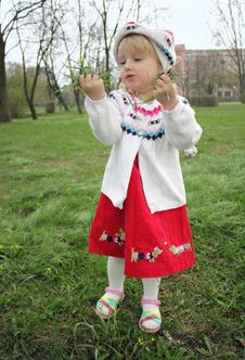 Free Little Girl Is Considering First Spring Flowers Stock Photos - 13860963
