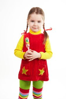 Free Girl Stand With Candy 2 Royalty Free Stock Photo - 13861435