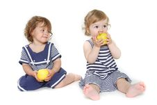 Two Toddler Girls With Green Apples Royalty Free Stock Photos