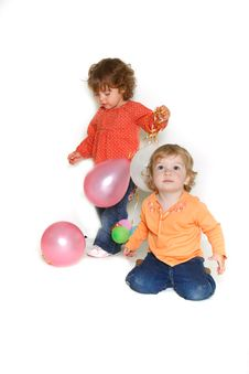Two Girls With Colorful Balloons Stock Images