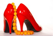Red Shoes And Amber Collar Or Chaplet Royalty Free Stock Photos